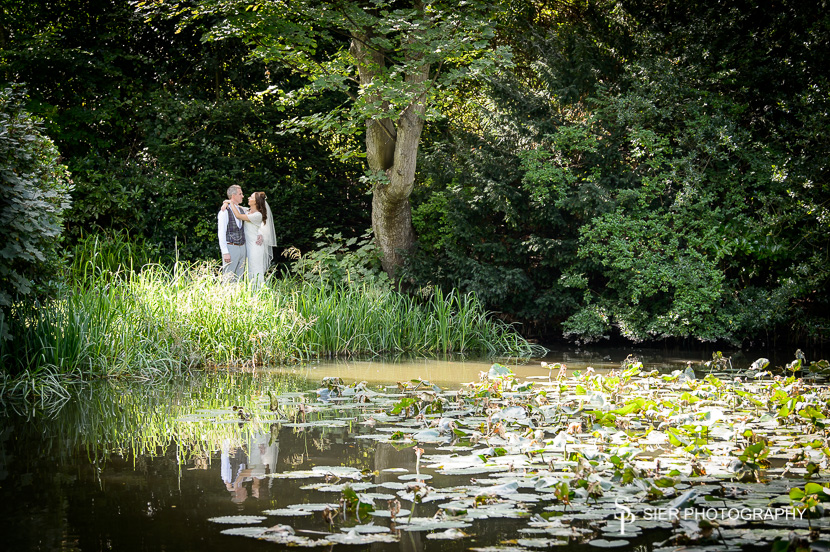 Wonderful wedding at the magnificent Kenwood Hall in Sheffield. Our couple are seen together from across the lake.