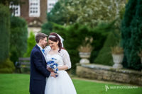 Wonderful summer wedding as our happy couple stand in the grounds of the magnificent Whitley Hall Hotel